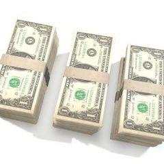Three stacks of dollar bills