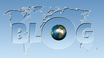 The word blog over an image of the world